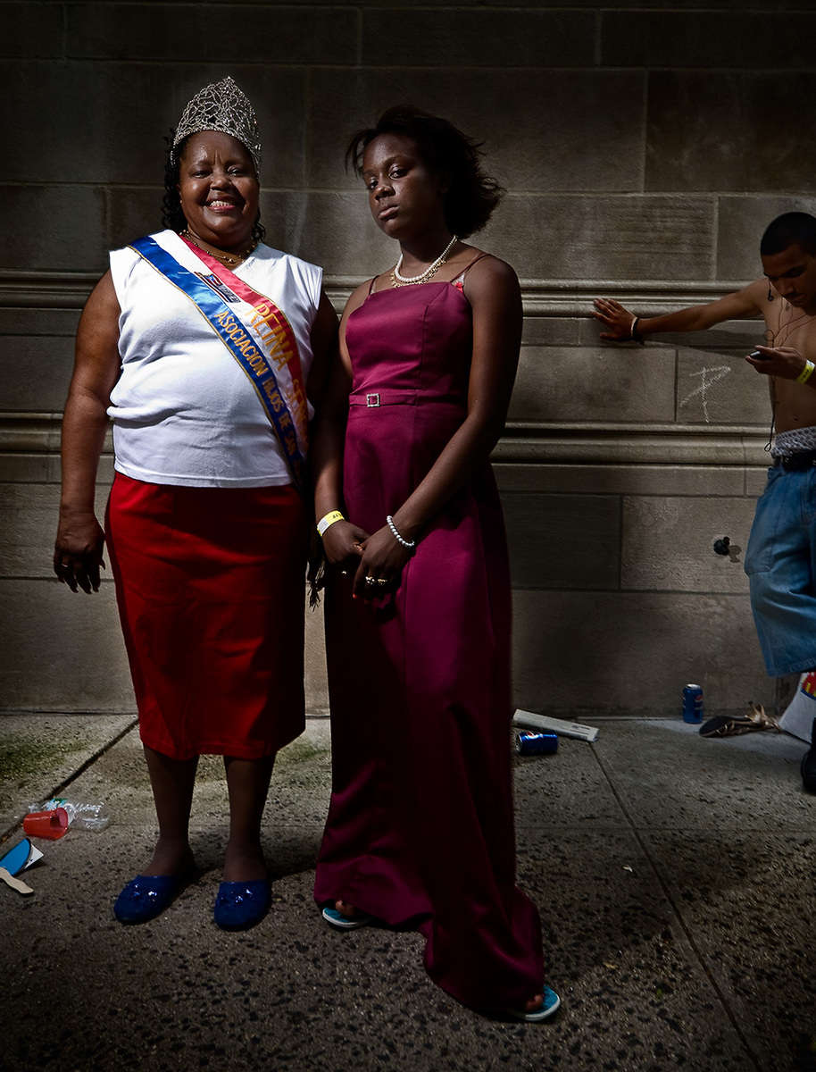 Mother and Daughter at the Puerto Rican Day Parade, NYC .. photographed between Fifth Avenue and Madison Avenue on the Upper Eastside, NYC. : Portraits : NY - Portrait Photographer Video, Architectural, Corporate Editorial Location Photography