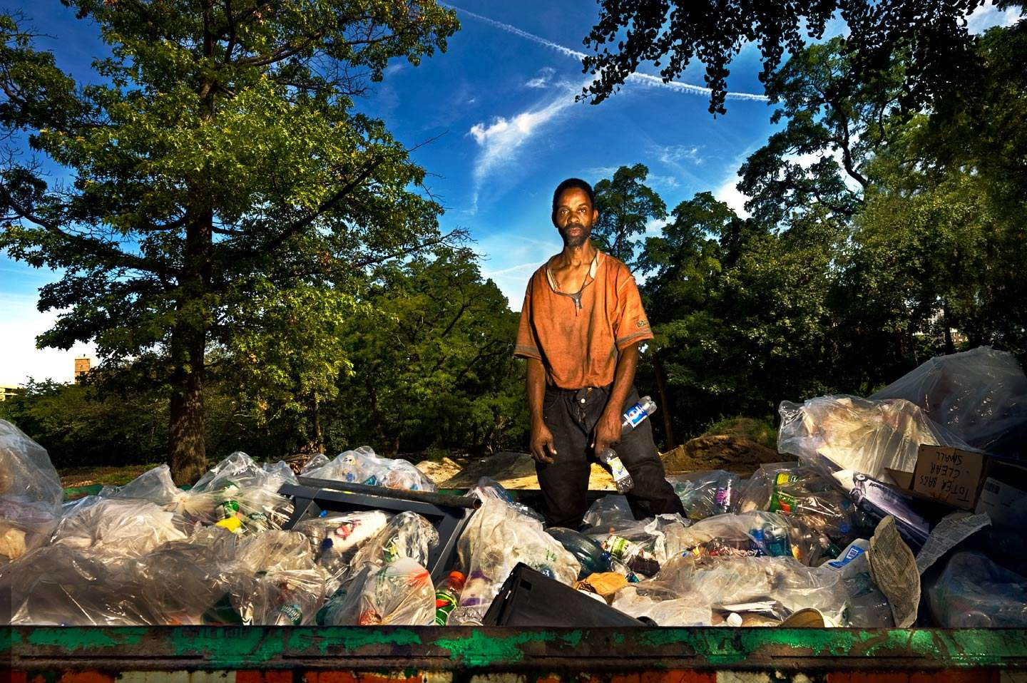 Ernest Phillips earning money in America by collecting bottles from the trash in Central Park, NYC : On The Road : NY - Portrait Photographer Video, Architectural, Corporate Editorial Location Photography