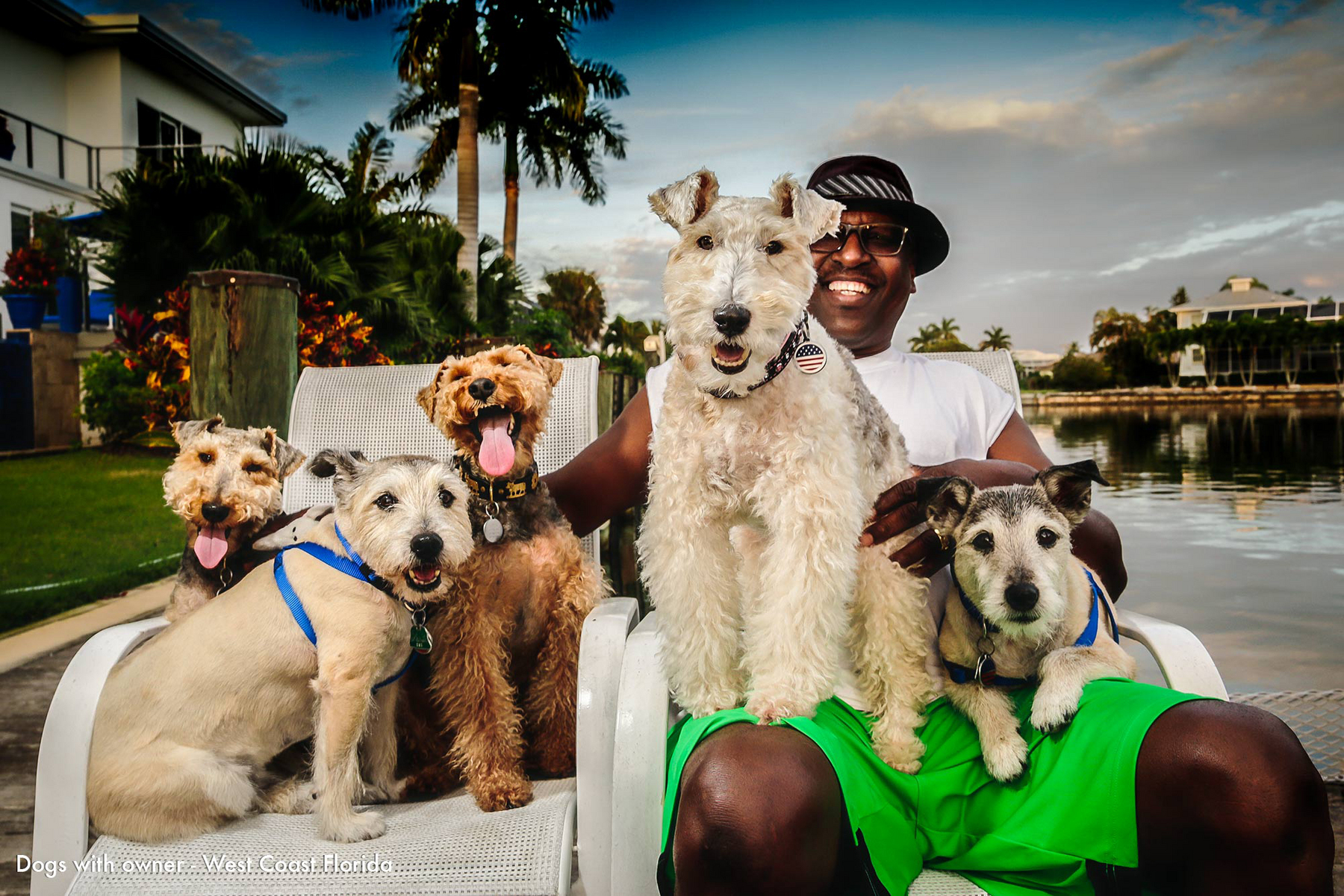 Marco Island Florida portrait of owner with dogs at waterfront property  : Portraits-Keywording : NY - Portrait Photographer Video, Architectural, Corporate Editorial Location Photography