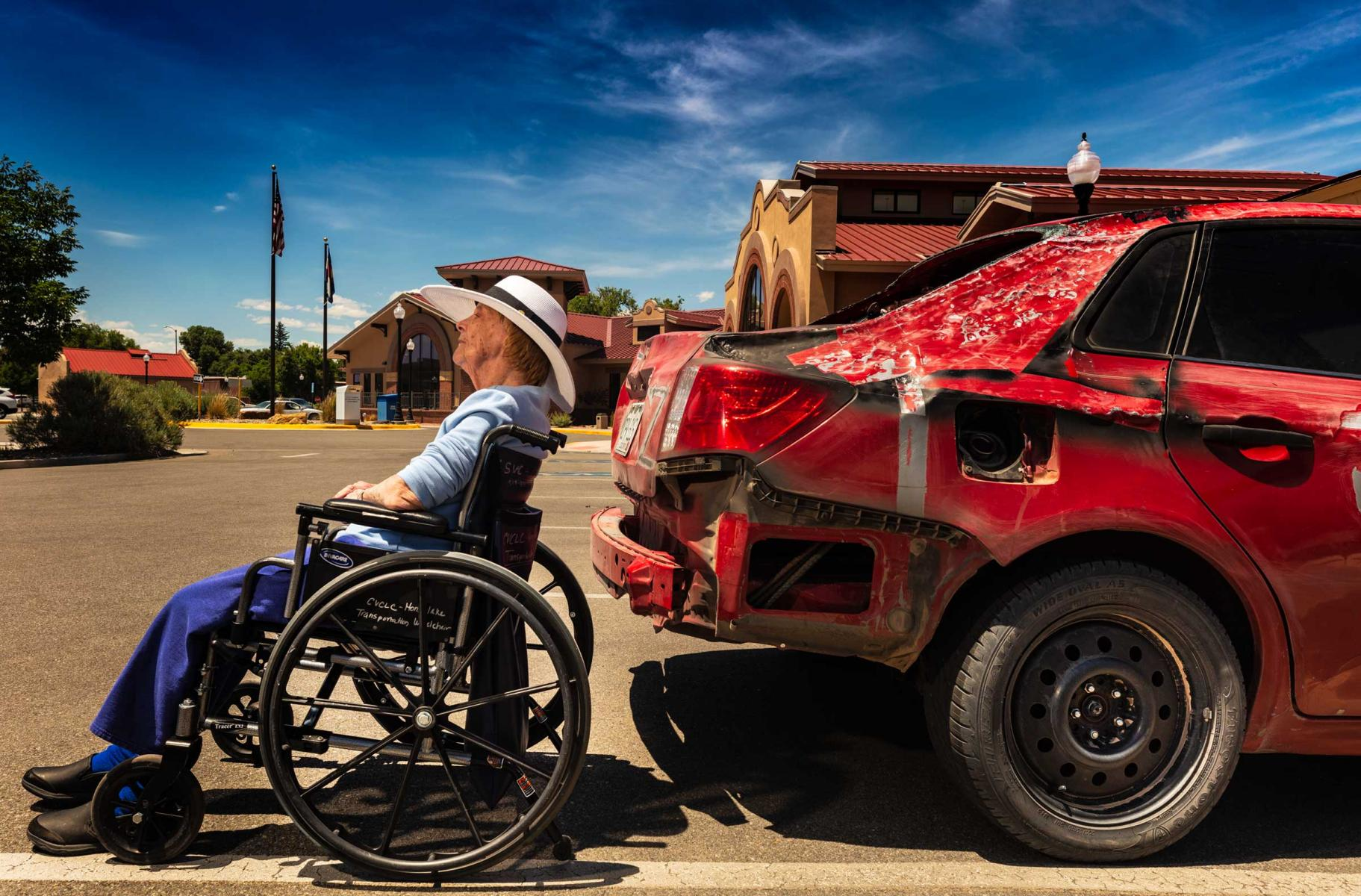 Alamosa at the parking lot with mom.  Saw this car and loved the relation between the car tire and my mom's wheelchair. : Visiting Mom : NY - Portrait Photographer Video, Architectural, Corporate Editorial Location Photography