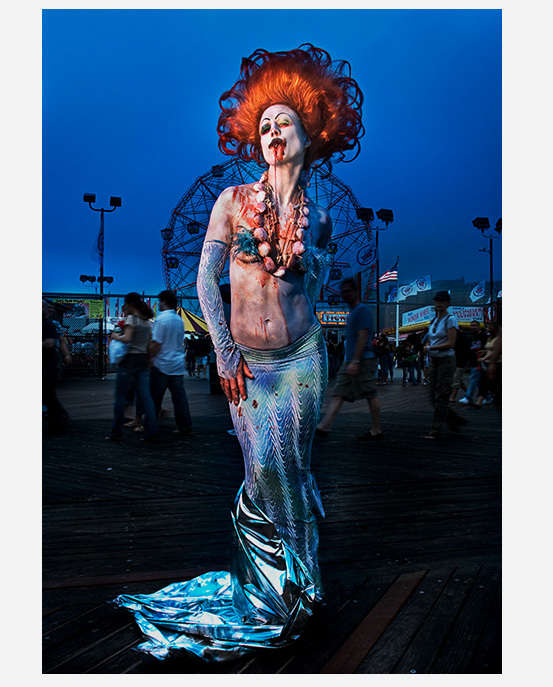 Mermaid Parade Coney Island Brooklyn NY portrait photographed on broadwalk with Ferris wheel in background : Portraits-Keywording : NY - Portrait Photographer Video, Architectural, Corporate Editorial Location Photography